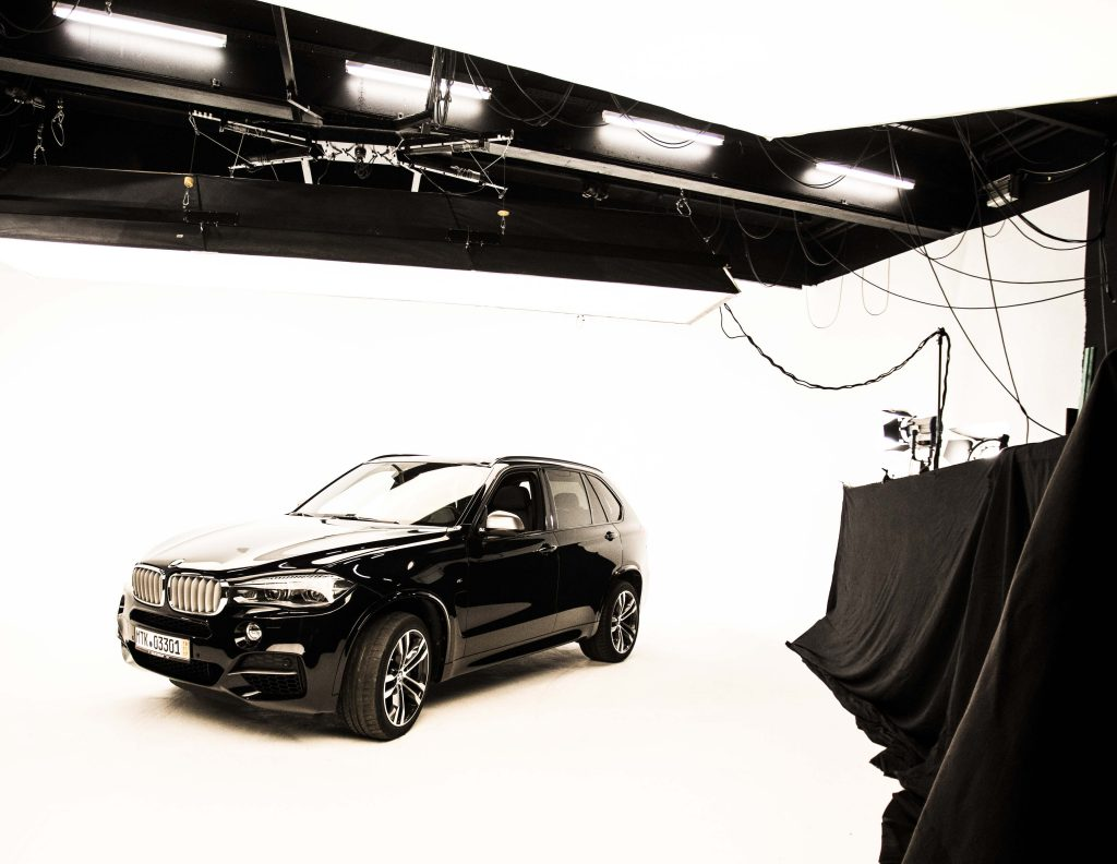 Backdrop with BMW in the white coving of the Westside Studios